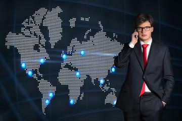 Businessman, phone conversation. world map.
