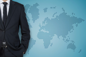 Businessman and world background wall (blue background)