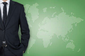 Businessman and world background wall (green background)