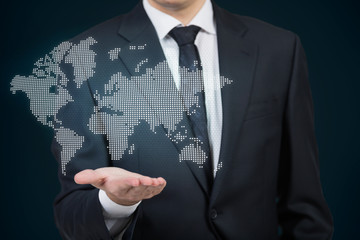 A businessman holding the hologram map