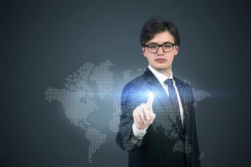 A businessman pointing out the hologram map