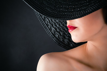fashionable glamorous woman in hat closeup