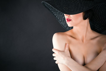 fashionable glamorous sexy woman in hat