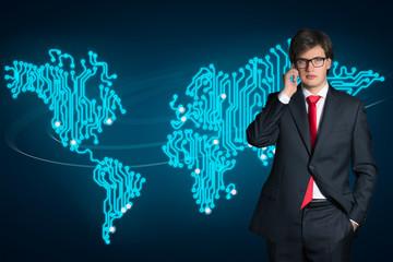 Businessman and Digital World map (phone conversation)
