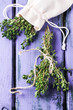 Top view on bunch of fresh thyme and thym in textile bag on