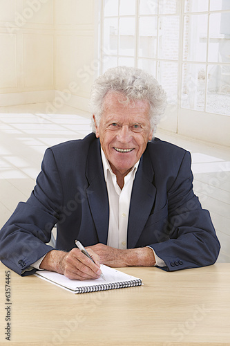 Confident Senior Businessman  in his office