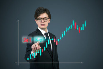 Businessman highlighting the buy option the forex screen