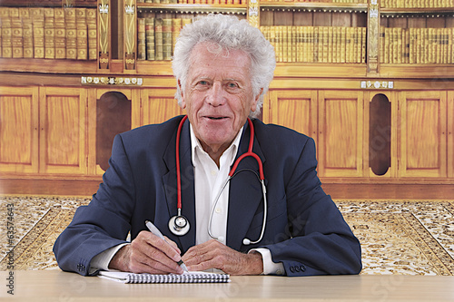 Portrait of a successful medical specialist in his office