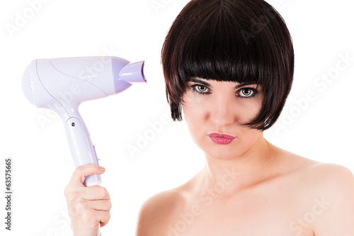glamor beautiful woman holding a hairdryer