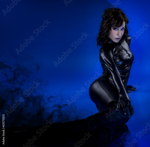 Sci-fi woman in black latex, dark smoke