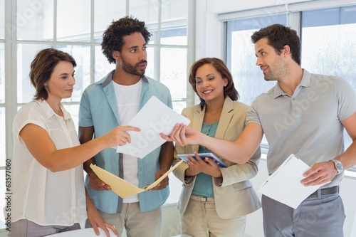 Business colleagues with documents in office