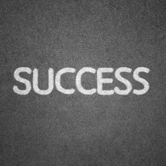 success text written on blackboard for background