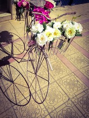 Vintage bike with flowers in its basket