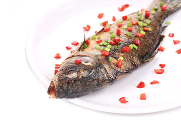 Fried fish with spring onion and red pepper.