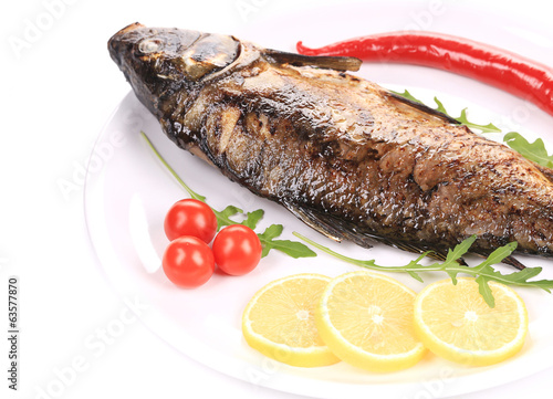 Fried carp with lemon and rukkola.