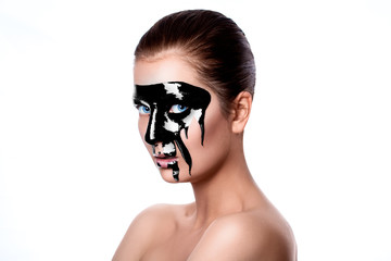 Black paint on woman's face