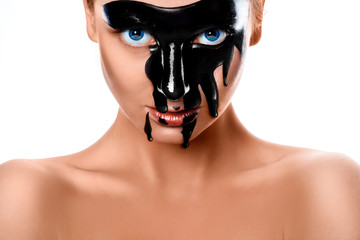 Close up photo of sexy woman with black paint on face