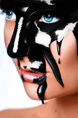 Vertical photo of sexy woman with black paint on face