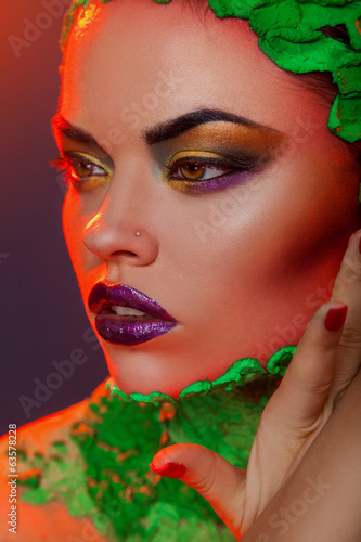 Sweet woman portrait with creative makeup