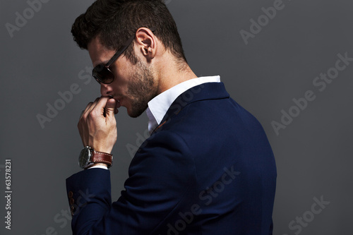 Handsome man wearing glasses and watchers