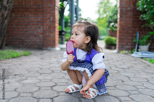girl eating purple ice cream