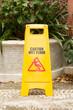 caution wet floor sign in the garden