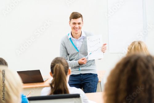 teacher talking with students