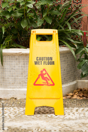 caution wet floor sign in the garden