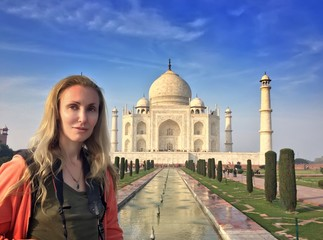European woman against Taj Mahal