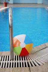 steps in a water pool and a children's ball