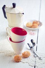 Two espresso coffee cups, italian mocha and small biscuits