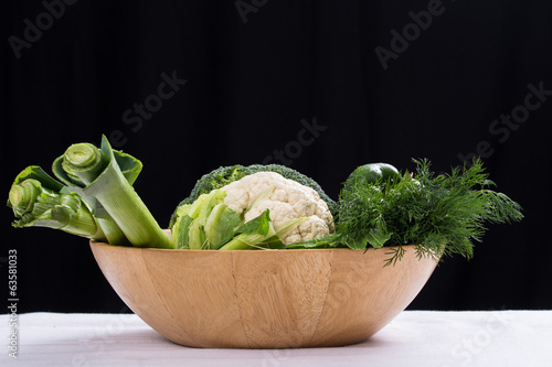 Fresh vegetables in the wooden bowl