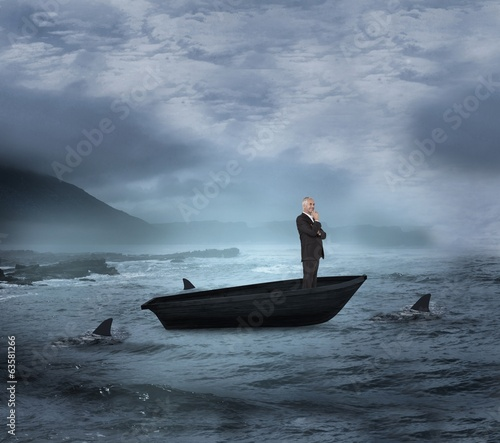 canvas print picture Composite image of happy businessman looking away in a sailboat