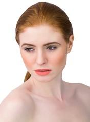 Beautiful redhead posing with hair tied
