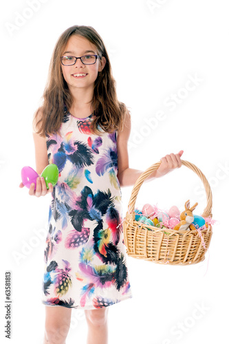 Girl with basket with easter eggs