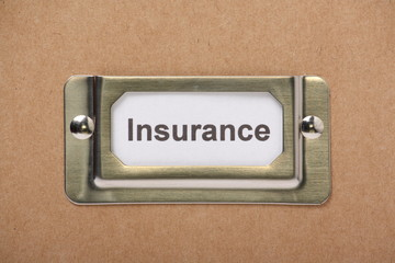 Insurance Drawer Label on a cardboard drawer or storage box