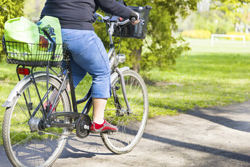 Obese woman riding a bike