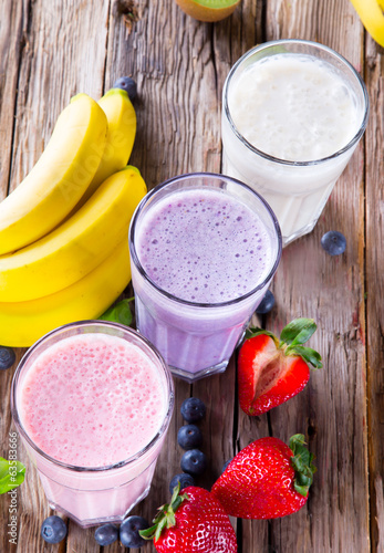 Fresh fruits milk shake on wood