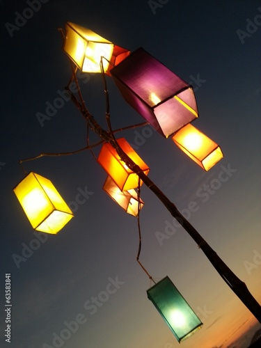 stand of  fabric lamps on the beach