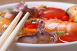 seafood soup with chopsticks macro horizontal