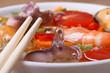 seafood soup with chopsticks macro horizontal
