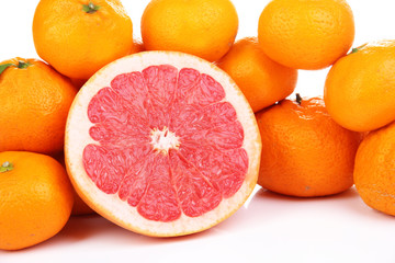 Ripe sweet tangerines and grapefruit, isolated on white