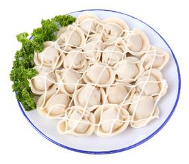 Meat dumplings - russian boiled pelmeni in plate isolated