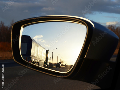 reflection seen through car side mirror - sunset