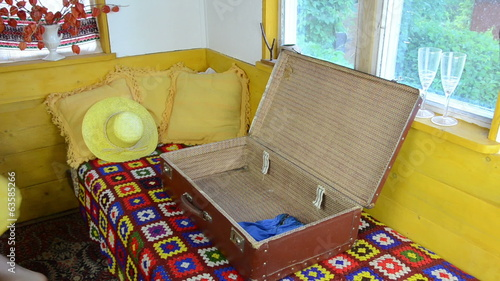 rural rooms stand open suitcase girl puts dresses blouses skirts