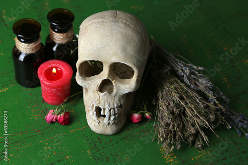 Composition with skull, and , magic potions, candle