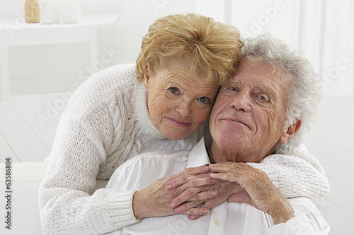 Happy smiling senior couple embracing together