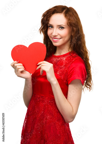 Young woman holding red heart