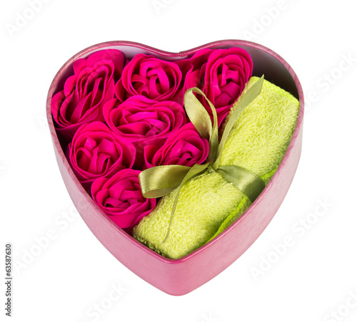 Gift box in shape of heart with handkerchiefs and towels