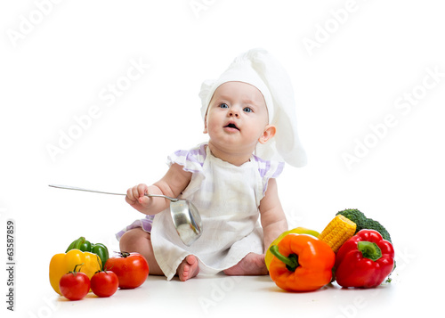 funny baby cook with vegetables